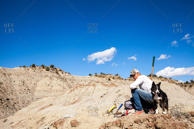 Paleontologist and his dog preparing to dig at a quarry in Utah's Kaiparowits Plateau