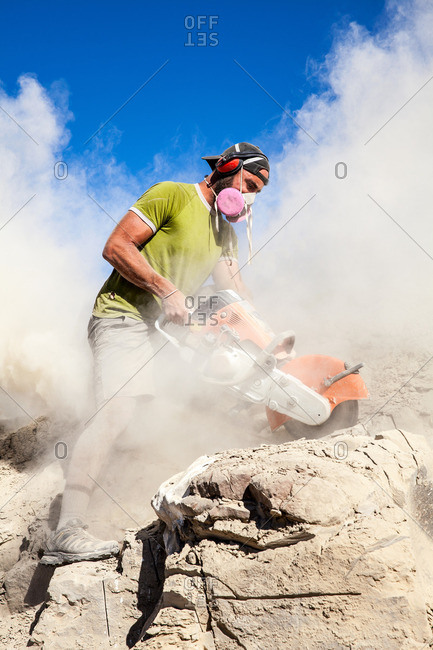 Kaiparowits, Utah, USA - September 20, 2015: Close up of a paleontologist using a rock saw to excavate a site in Utah's Kaiparowits Plateau