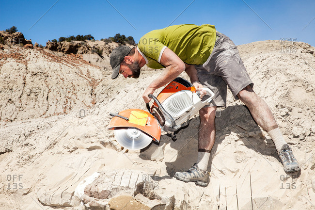 Kaiparowits, Utah, USA - September 20, 2015: Paleontologist using a rock saw while excavating in Utah's Kaiparowits Plateau