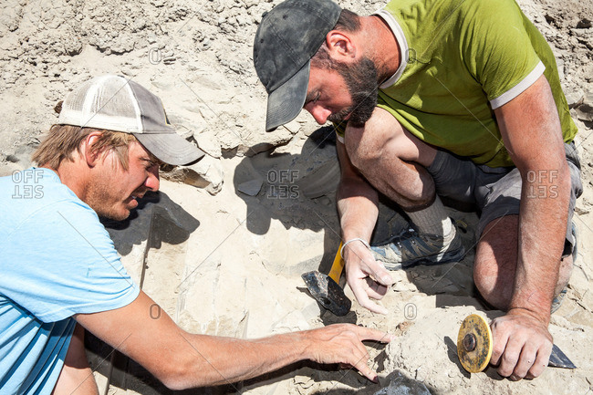 Two paleontologists having a discussion on an excavation site in Utah's Kaiparowits