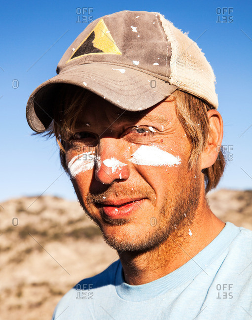 Portrait of a paleontologist with plaster on his face in the field during a dig in Utah's Kaiparowits Plateau