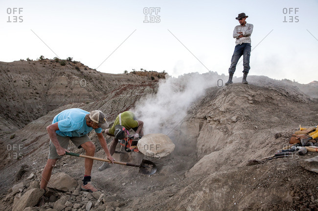 Kaiparowits, Utah, USA - September 20, 2015: Three paleontologists working on an excavation site in Utah's Kaiparowits Plateau