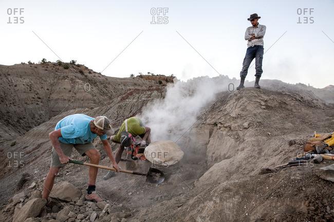 Kaiparowits, Utah, USA - September 20, 2015: Three paleontologists working on an excavation site in Utah's Kaiparowits Plateau