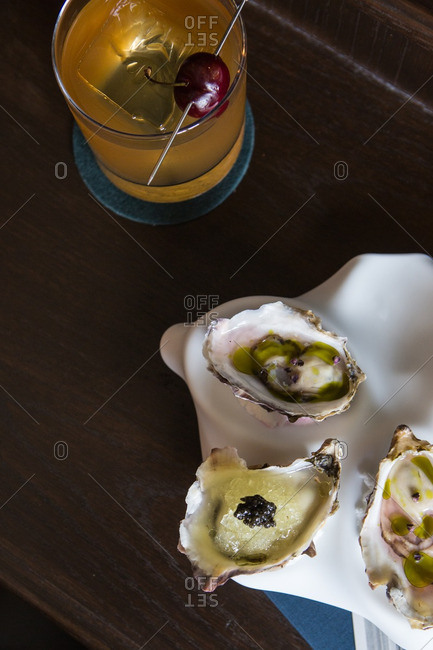 Overhead view of oysters and cocktail