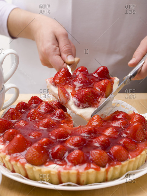 A piece of strawberry tart on a cake slice