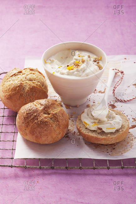 Homemade buttermilk rolls with spread with sweet Quark