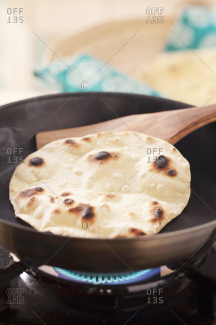 Cooking tortilla flatbread in a pan