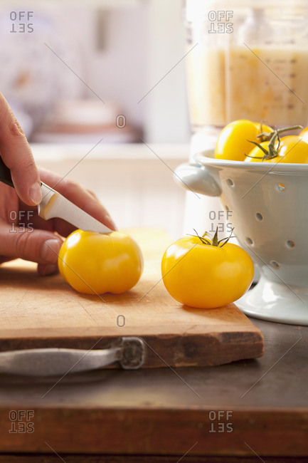 Yellow tomatoes being sliced