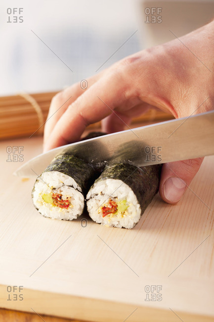Maki sushi being sliced - Offset
