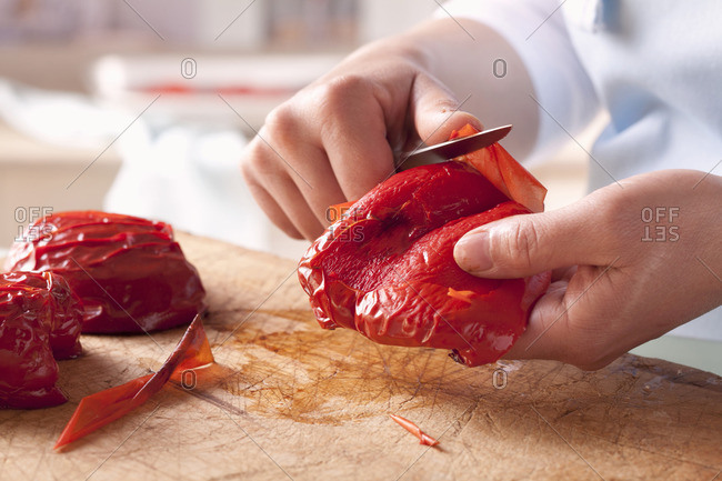Skin being removed from roasted pepper