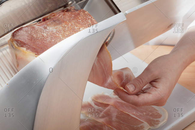 Cutting ham into wafer-thin slices with a slicing machine