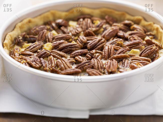 Pecan and apple pie in pie dish