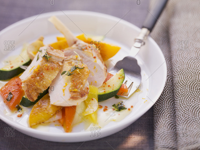 Guinea fowl breast on a warm vegetable and peach salad