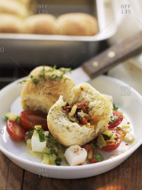 Spicy stuffed tubular pasta on a tomato and feta salad