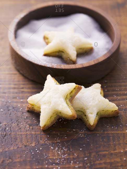 Star-shaped biscuits topped with marzipan and pistachios