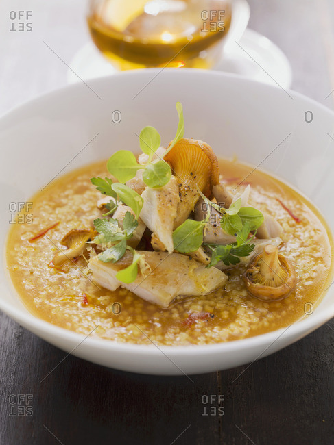 Rabbit with chanterelle mushrooms on saffron jelly with couscous