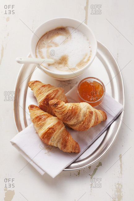 Croissant with marmalade and cafe au laity