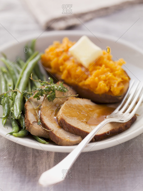 Roast pork with sweet potatoes and beans