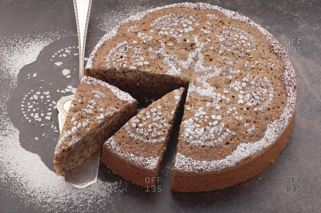 Almond and chocolate cake decorated with icing sugar