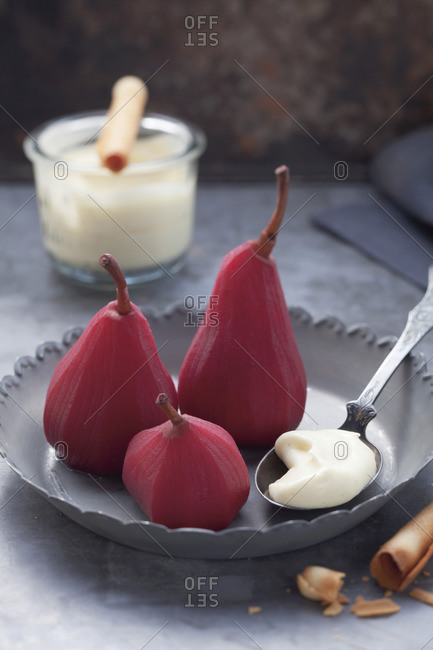 Pears poached in red wine, with vanilla cream
