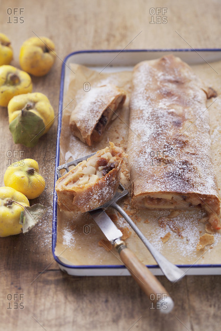 Pear and quench strudel on a baking tray, sliced