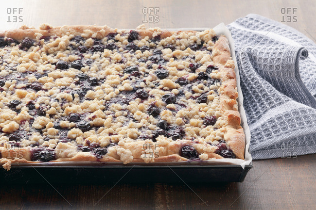 Blueberry crumble cake on a baking tray