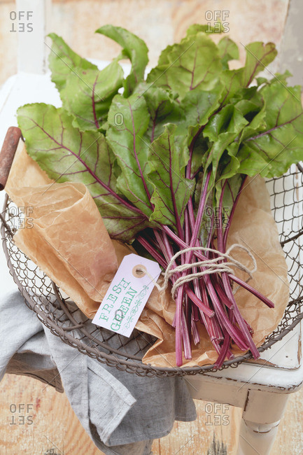 Fresh beetroot leaves in a wire basket