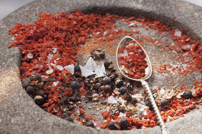 Roughly crushed spices in a mortar
