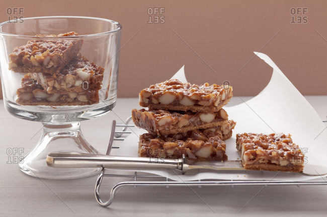 Nut slices on a cooling rack and in a dessert glass