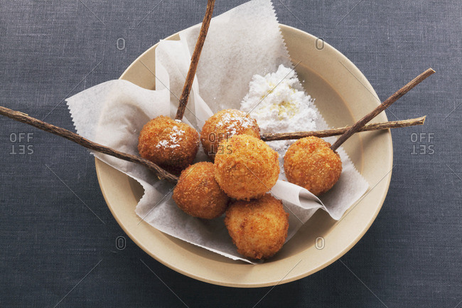 Deep-fried sweet dough balls with icing sugar