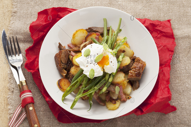 (typical Tirolean dish using leftovers) with potatoes, pork, green beans and a poached egg