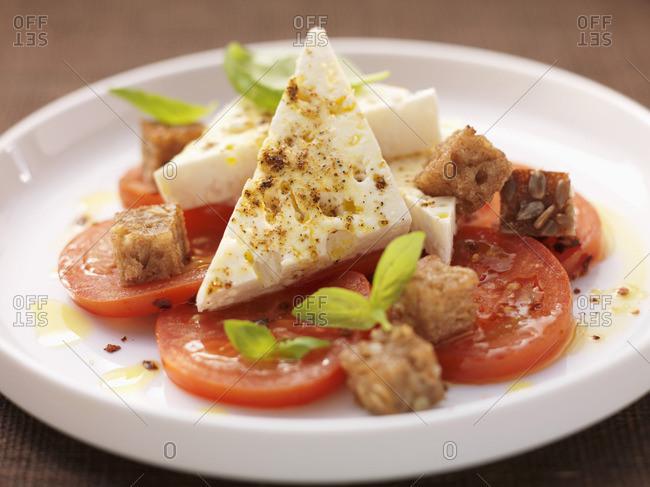 Warm feta on a tomato salad