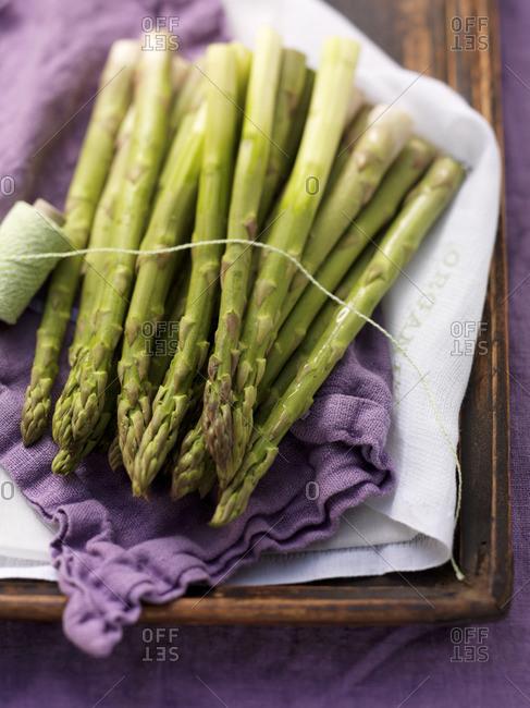 Green asparagus on a purple cloth