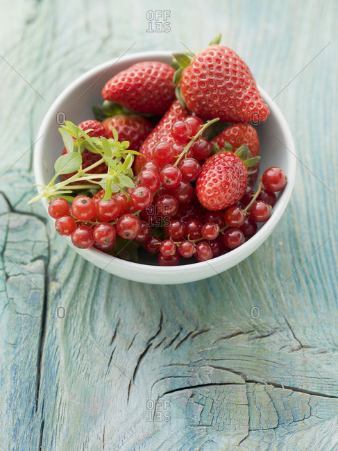 A bowl of strawberries and redcurrants
