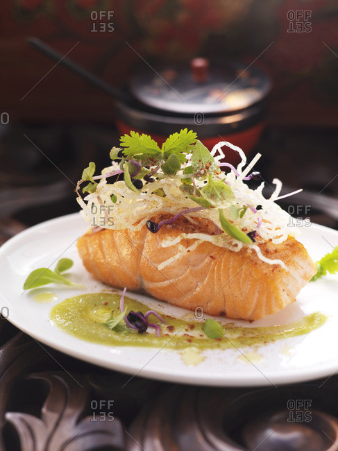 Salmon fillet on a green pepper and ginger sauce with fried rice noodles