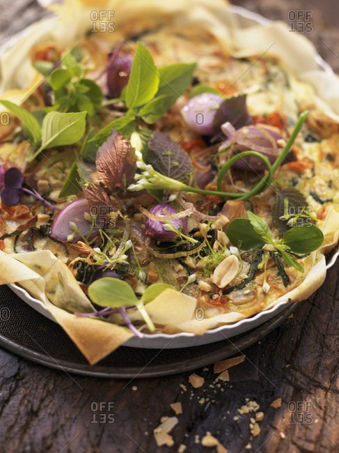Shallot and pepper tart with a herb salad (Asia)