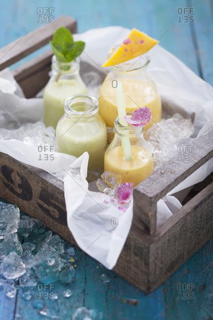 Mango and mint lassies on ice