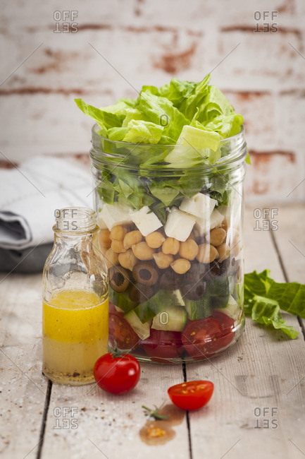 A layered chickpea salad in a jar