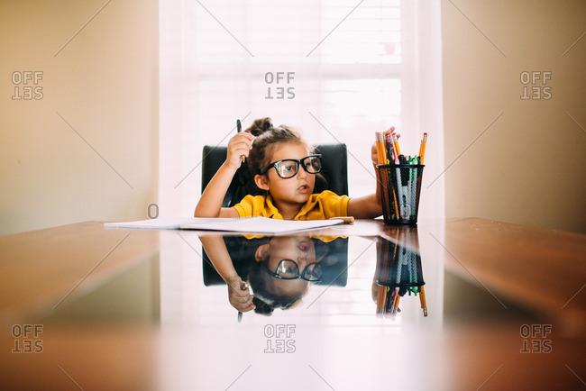 Studious girl grabbing pencil