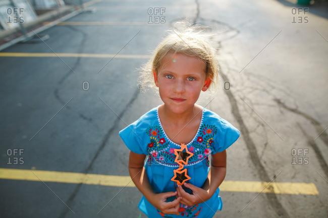 Girl in sunlit parking lot