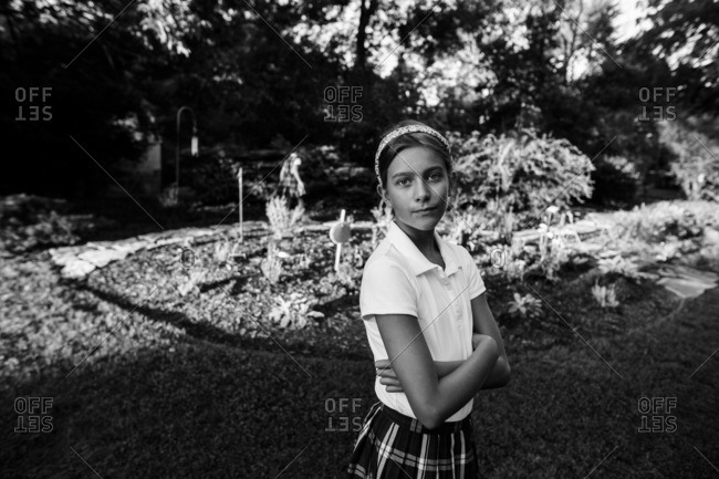 Girl in school uniform in yard
