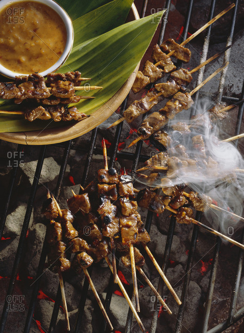 Beef Satay Cooking on a Grill; Smoke