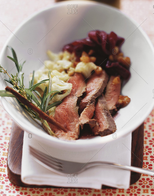 Duck breast in red wine & herb sauce and cauliflower