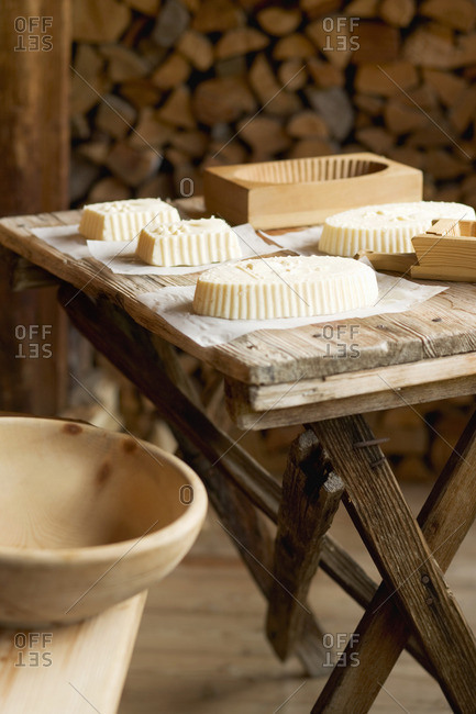 Farmhouse butter and various wooden molds on wooden table