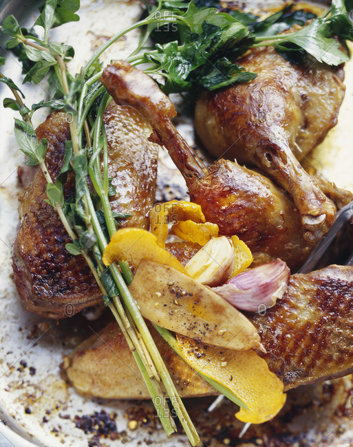 Roast duck with orange peel, garlic and herbs