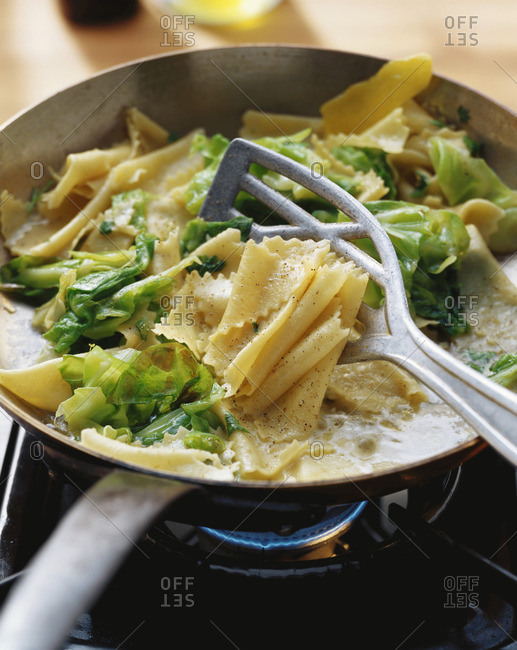 Krautfleckerl (cabbage and pasta dish) in frying pan