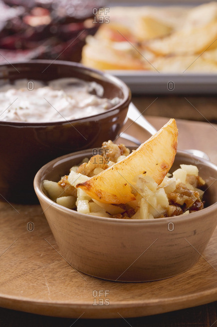 Turnip wedges with a pear and walnut salad and a dip
