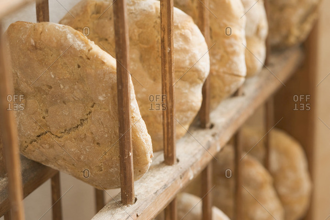 Freshly-baked bread (from wood-fired oven) in rack