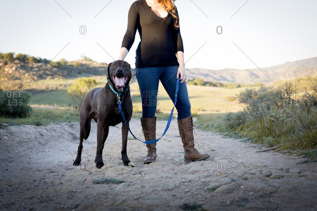 Woman on trail with her leashed dog