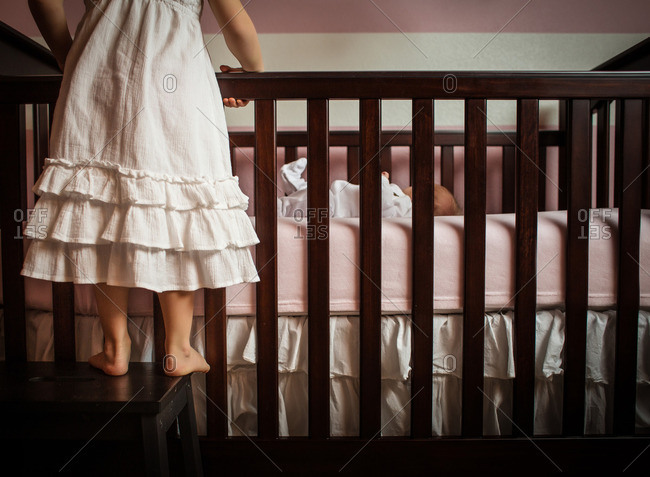Brilliant Girl Standing On A Step Stool Next To A Crib Stock Photo Ibusinesslaw Wood Chair Design Ideas Ibusinesslaworg
